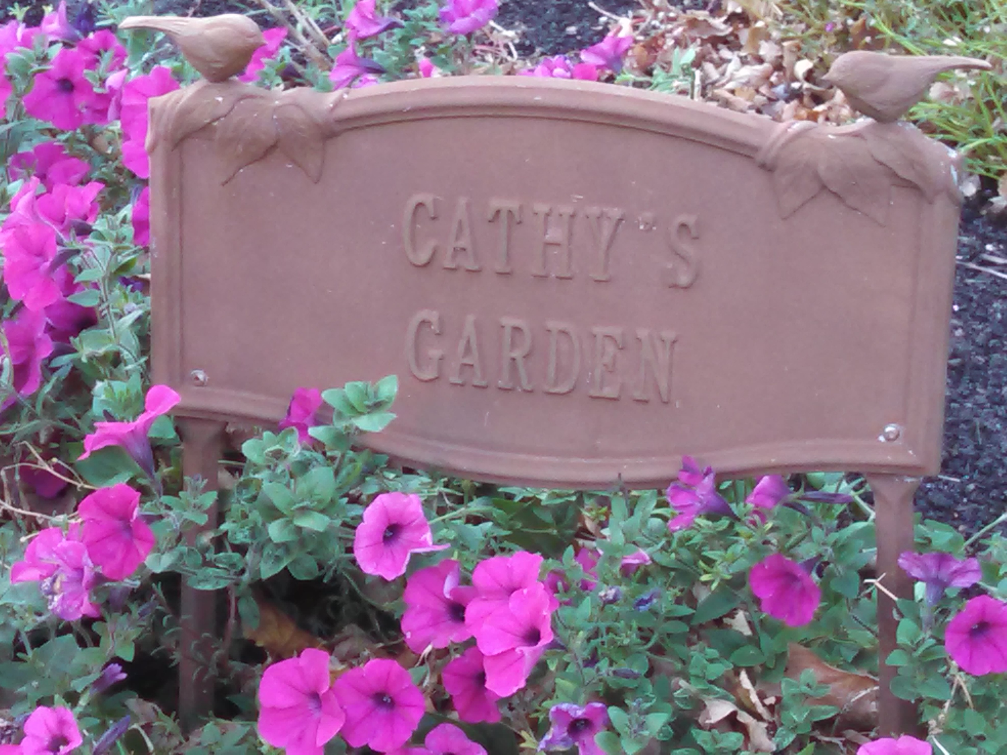 cathys garden sign with flowers