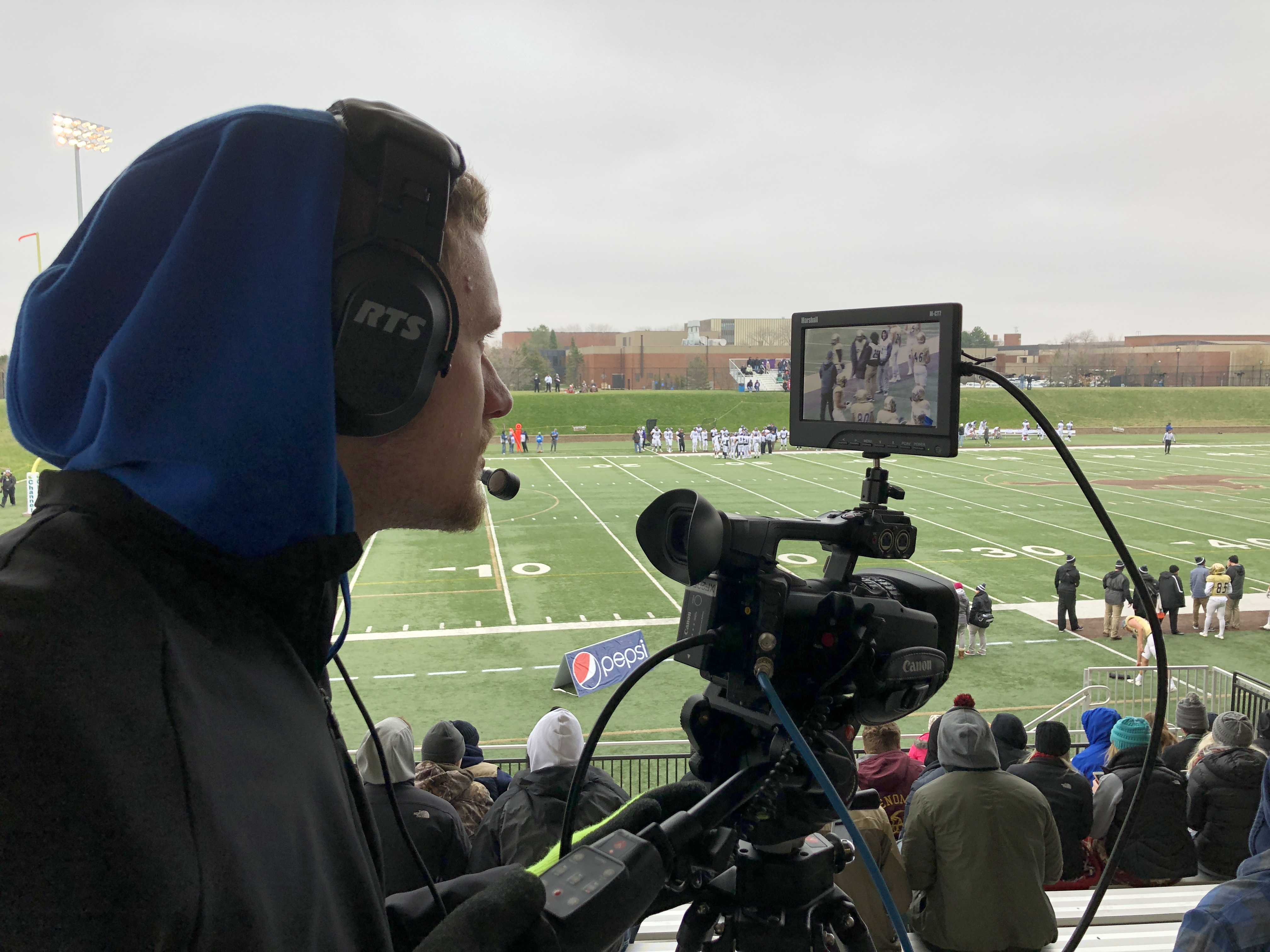 Aaron Bible operates a camera for a Mustang Football broadcast