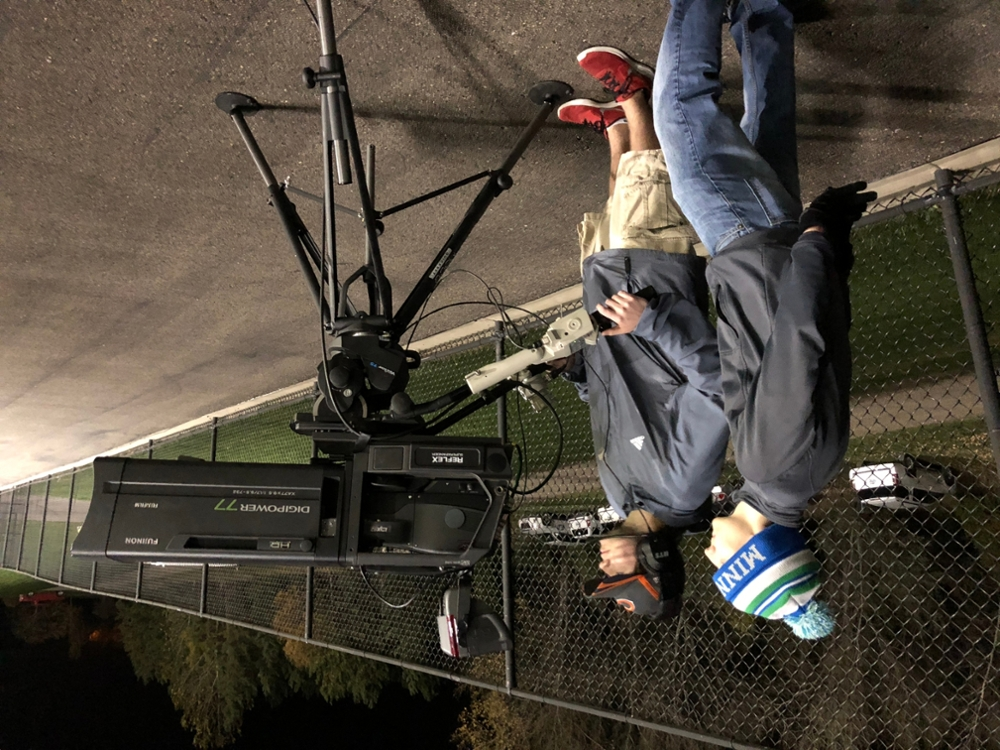 Mitch Riibe and Sam Proell use a state of the art camera from Midco Communications on the sidelines at the Marshall HS Football game