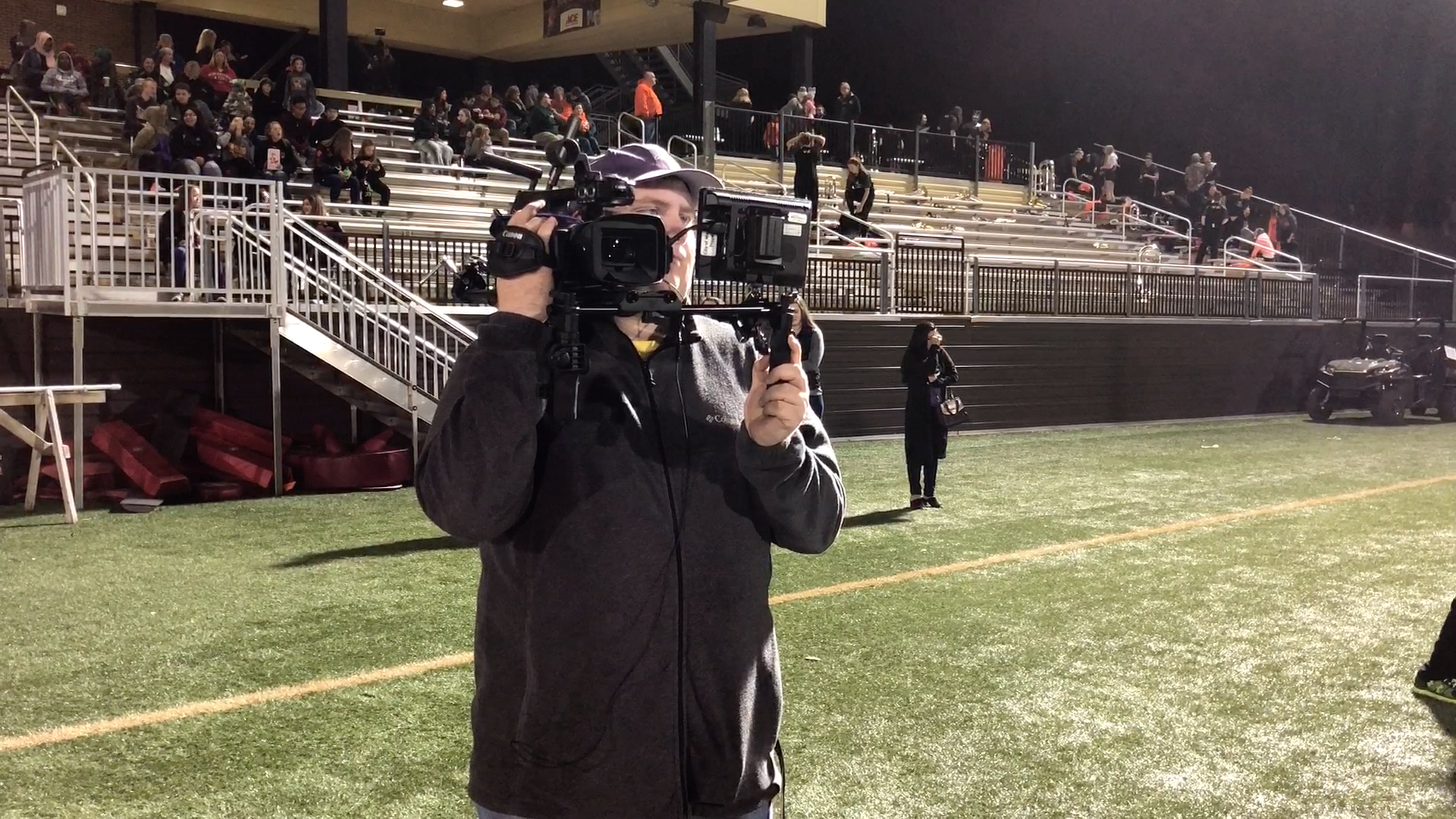 Nick Dalhoff working wireless sideline camera at a Marshall HS football game