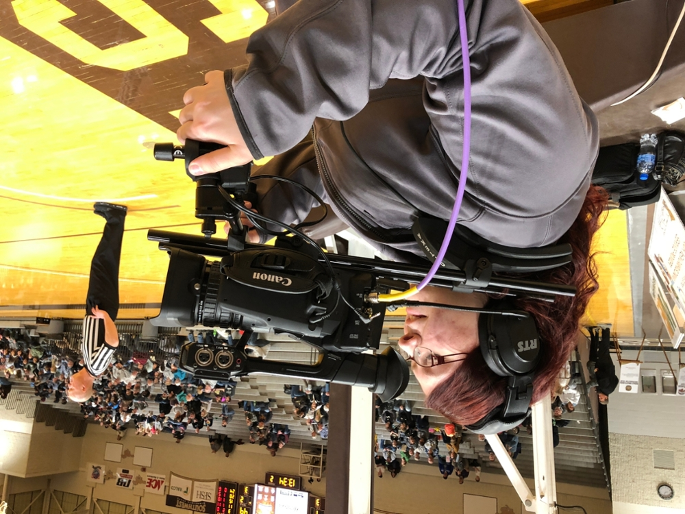 Laura H. operates a court side camera in the RA facility