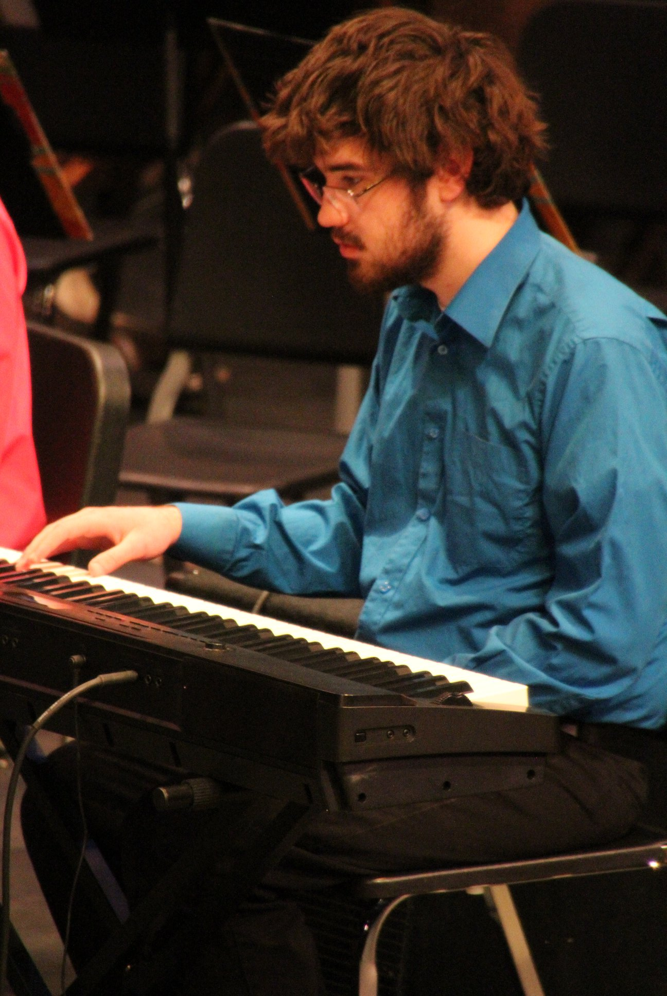 student playing keyboard with the Symphonic Chamber Winds