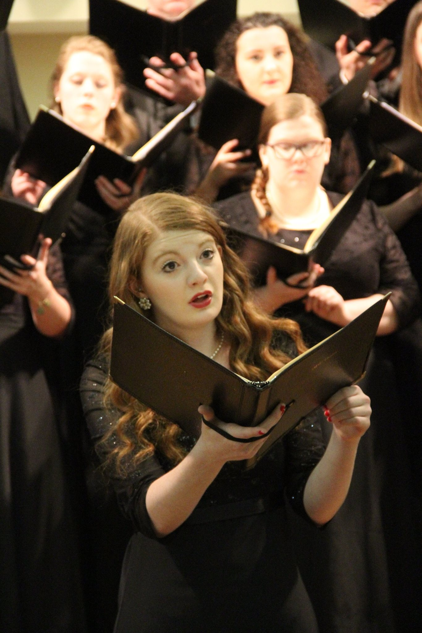 SMSU Music student singing with the SMSU Chorale