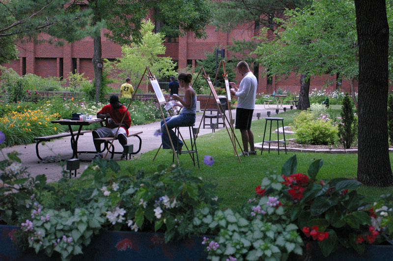 Students painting on campus