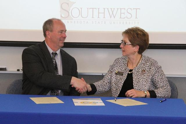 SMSU President Dr. Connie J. Gores, right, and Anoka-Ramsey President Kent Hanson
