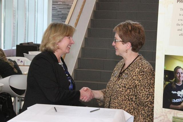 North Hennepin President Barbara McDonald, left, and SMSU President Dr. Connie Gores