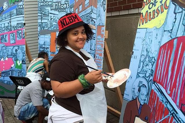 "Sophia Pone, a Summer Bridge student, participated in ""Spill Paint Not Blood"" mural-painting"