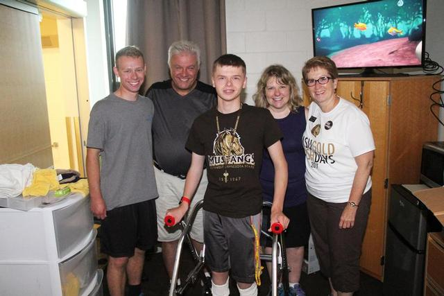 From left: Zach, Paul, Jacob and Monica Zyla and President Connie J. Gores