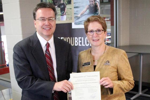 STI President Bob Griggs, left, and SMSU President Connie J. Gores