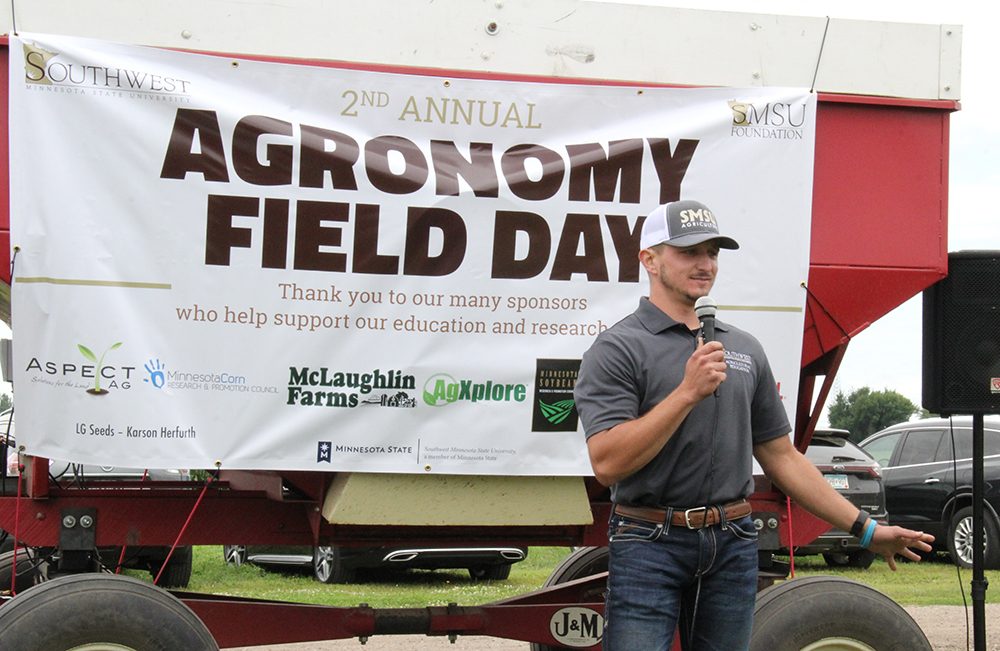 Senior Brock Fox talks to those at the second annual Agronomy Field Day