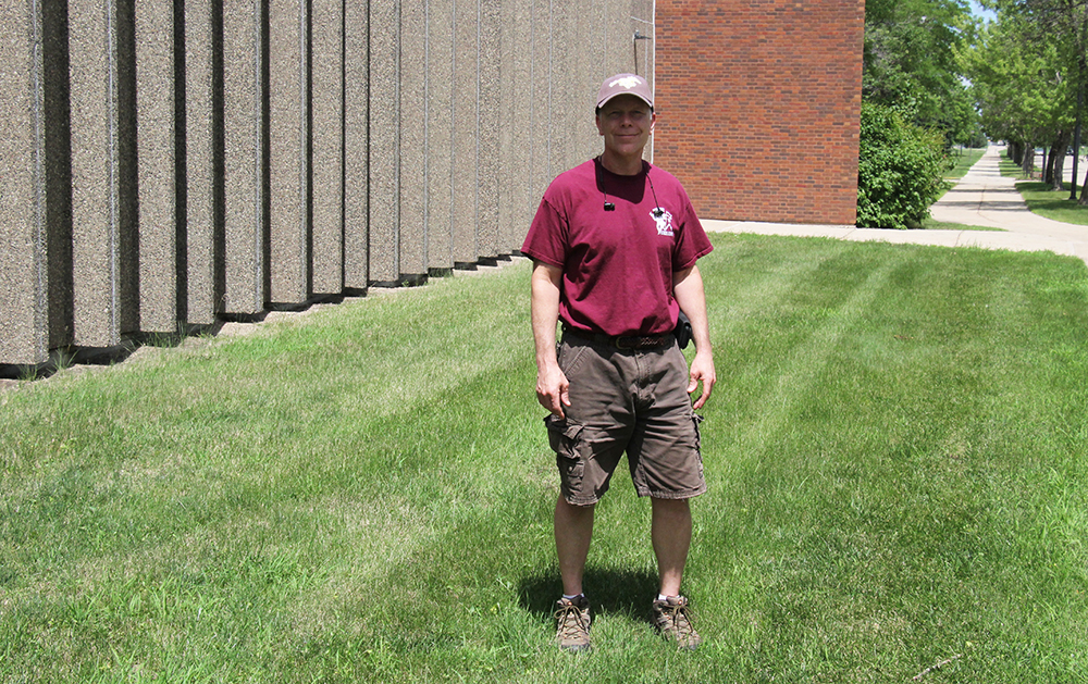 Jeff Jennings stands at the site of the new Fine Arts Entrance Garden
